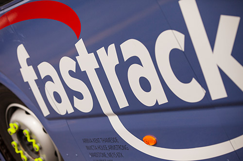 Fastrack logo on the side of a Fastrack bus.